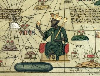Copie d'une carte réalisée en Espagne en 1375 représentant l'empereur du Mali Kankan Musa tenant une pépite d'or.