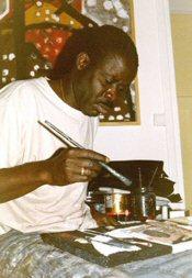 Ernest Duku dans en plein travail créatif