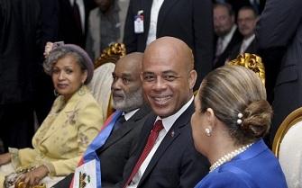 Michel Martelly en compagnie de son �pouse Sophia et de Ren� Pr�val