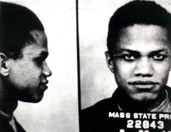 Malcolm X photographié lors de son arrestation. Il allait passer plusieurs années en prison